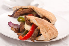 Pita bread sandwich with meat and vegetables Royalty Free Stock Photography