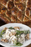 Pita bread served with cheese,butter, walnuts Royalty Free Stock Photography
