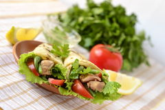 Pita bread stuffed with vegetables and fish Stock Images
