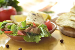 Pita bread stuffed with vegetables and fish Stock Photos