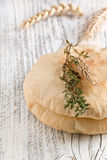 Pita bread with thyme and ears Royalty Free Stock Photo
