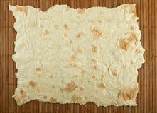 Pita chleb na bambusowej macie Fotografia Stock