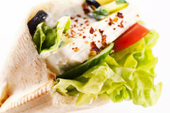 Pita with feta. Pita bread stuffed with Feta and vegetables stock photos