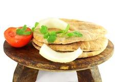 Pita flat bread or nan closeup in pure white background. Pita flat bread or nan with tomato onion and coriander in pure white background Stock Images