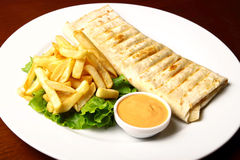 Pita with fries and sauce Royalty Free Stock Image