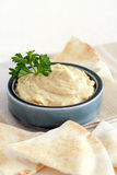 Pita and hummus Stock Images