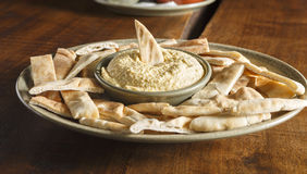 Pita and Hummus. Hummus with Pita Bread on a Wooden Table stock photography