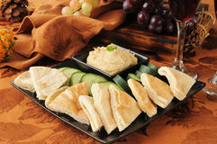 Pita and hummus platter Stock Images