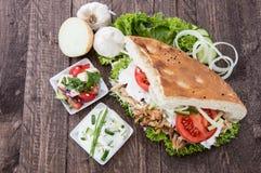 Pita and Kebab on wood Stock Images
