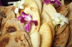 Pita and Orchids Stock Photography