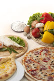 Pita, pizza and armenian khachapuri. With ingredients Stock Images