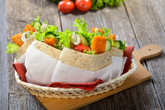 Pita sandwich with fish fingers Royalty Free Stock Photo