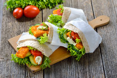 Pita sandwich with fish fingers Royalty Free Stock Photography