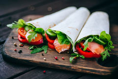 Pita sandwich stuffed with fish Stock Images