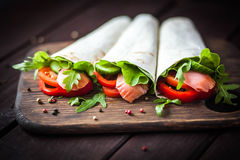 Pita sandwich stuffed with fish Stock Photos