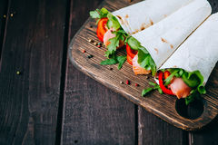 Pita sandwich stuffed with fish Royalty Free Stock Photo