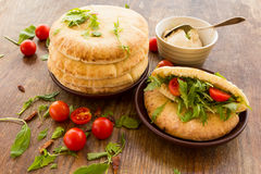 Pita with tomatos, cheese and salad mix Royalty Free Stock Photos