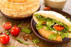 Pita with tomatos, cheese and salad mix Stock Photo