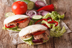 Pita with tuna and vegetables close-up. Horizontal Stock Photography