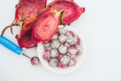 Pitahaya crafted in balls on white background. Sliced tropical fruit. Dessert serving. Carved fruit. Dragon fruit balls. Bright. Colors. Healthy nutrition stock image