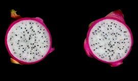 Pitahaya halves on block. Pitahaya (Dragonfruit) cut in halves isolated on black Stock Photography