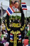 Pitak Siam Anti-Government Rally in Bangkok, Thailand. A protester holds a portrait of the Thai King in the rally.The rally was holded by Pitak Siam on Nov 24 at Royalty Free Stock Photography
