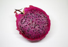 Pitaya on white background. Dragon fruit cut on half. Healthy breakfast. Tropical fruit. Dragonfruit isolated. Bright pink exotic fruit with black seeds. Pine Royalty Free Stock Photos