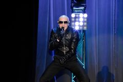 Rapper Pitbull performing on stage. Pitbull  Armando Christian Pérez . Music producer. Performing on stage with his backup dancers Stock Images