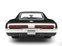 Pitch black American vintage muscle car - back view closeup shot Royalty Free Stock Photography