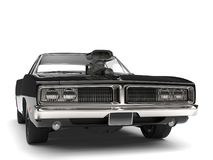Pitch black American vintage muscle car - front view closeup shot Royalty Free Stock Image