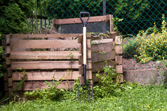 Pitch fork. At a wooden compost pile frame Royalty Free Stock Images