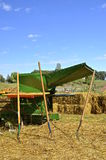Pitch forks in front of threshing machine Stock Photo