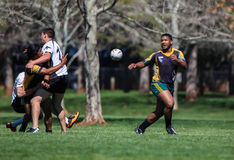 Pitch Out. Redding California, USA- March 15 2014: A Humboldt player makes a pitch out before he get's tackled   during a rugby match between the Shasta Royalty Free Stock Image
