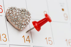Pitch peg on calendar and love symbol love day Royalty Free Stock Photos