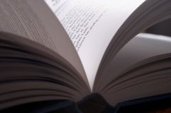 Pitched book. In backlight, flip a book open Royalty Free Stock Image