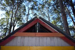 Pitched roof apex closeup. Abstract triangular coloured wooden roof apex landscape royalty free stock photos