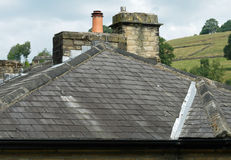 Pitched-slate-roof. Pitched slate roof with valley stock photo