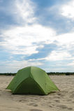 Pitched tent in the desert on sunny day Royalty Free Stock Photo