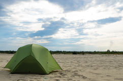 Pitched tent in the desert on sunny day Royalty Free Stock Images