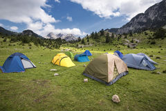 Pitched Tents in the Mountain Valley royalty free stock photos