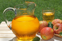 Pitcher of Apple Juice Stock Photography