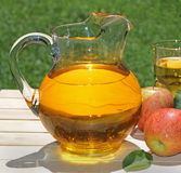 Pitcher of Apple Juice Royalty Free Stock Image