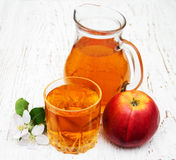 Pitcher with apple juice Royalty Free Stock Images