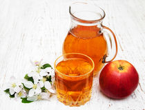 Pitcher with apple juice Stock Image