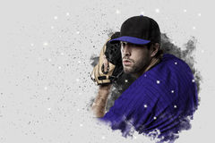 Pitcher Baseball. Player with a blue uniform coming out of a blast of smoke Royalty Free Stock Photo