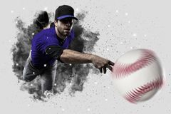Pitcher Baseball. Player with a blue uniform coming out of a blast of smoke Stock Image