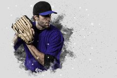 Pitcher Baseball. Player with a blue uniform coming out of a blast of smoke Royalty Free Stock Photos