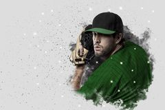 Pitcher Baseball. Player with a green uniform coming out of a blast of smoke Stock Images