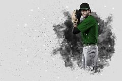 Pitcher Baseball. Player with a green uniform coming out of a blast of smoke Stock Photography