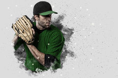 Pitcher Baseball. Player with a green uniform coming out of a blast of smoke Stock Photos
